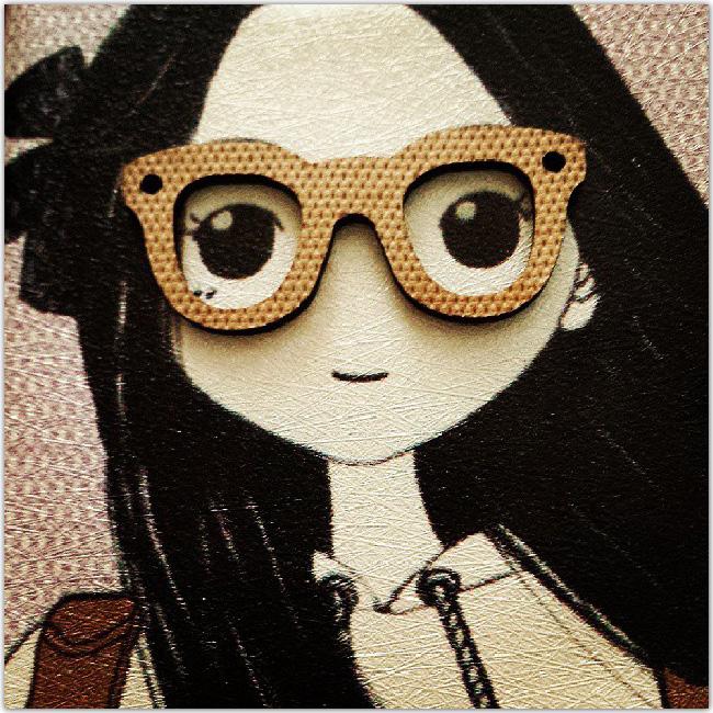 poupée à lunettes