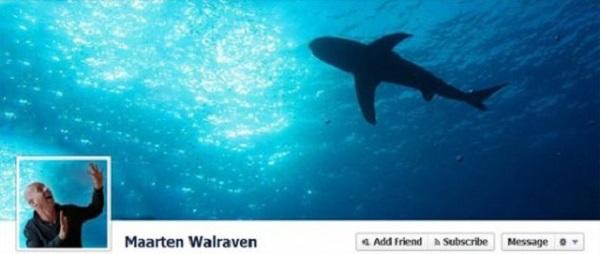 Photo de couverture Facebook d'une personne qui est sous l'eau à côté d'un requin